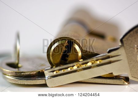 Close up keys and lock Cylinder on white background
