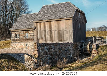 Bijotai, Lithuania: water mill in Dionisas Poska Manner in spring