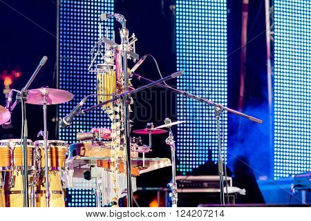 drum kit on empty outdoor stage before concert