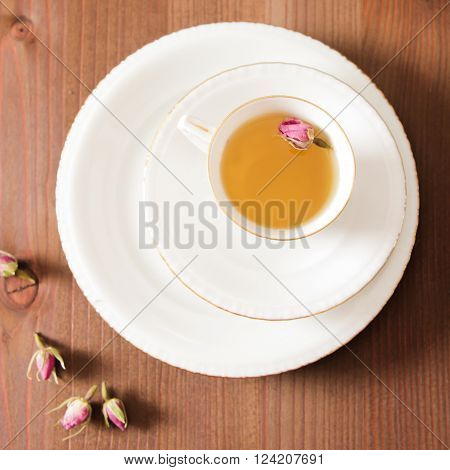 Vintage Cup Of Tea With Rosebuds,on Brown Background