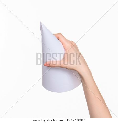 The white cone of the props in the female hands on white background with  right shadow