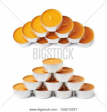 Pyramid of tealight paraffin wax orange candles isolated over the white background, set of two different foreshortenings