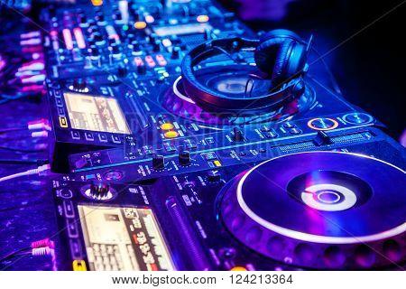 Dj mixer with headphones at the nightclub
