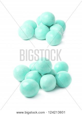 Pile of sugar coated ball candies isolated over the white background, set of two different foreshortenings