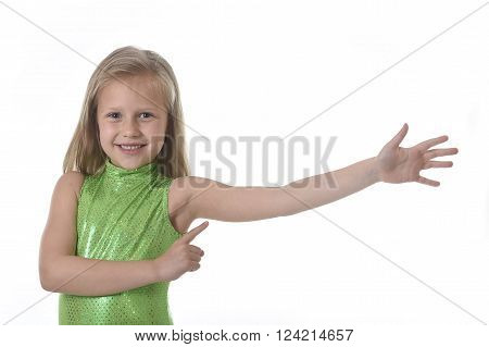 sweet little girl with blond hair and blue eyes smiling happy posing isolated on white background pointing her arm