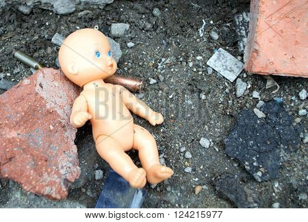 doll in the ruins of the house. War.