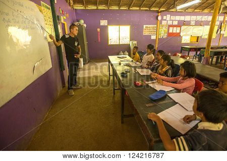 KOH CHANG, THAILAND - FEB 8, 2016: Unidentified children in lesson at school by project Cambodian Kids Care to help deprived children in deprived areas with education on Koh Chang island.