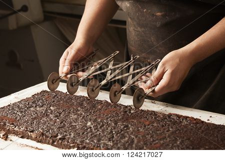 Black Man Chief Use Professional Vintage Separator To Split Chocolate Cake On Equal Portions Before