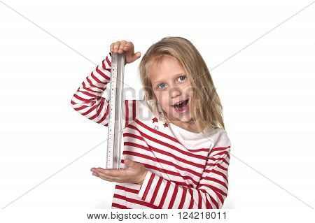 sweet beautiful female child 6 to 8 years old with cute blonde hair and blue eyes holding ruler isolated on white background in education and primary or junior school supplies concept
