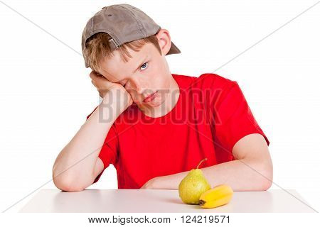 Bored Male Child With Fruit