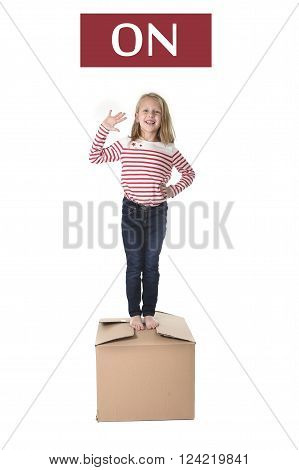 cute and sweet blond hair child stading on top of cardboard box isolated on white background in learning english prepositions and words language card set for education school textbook