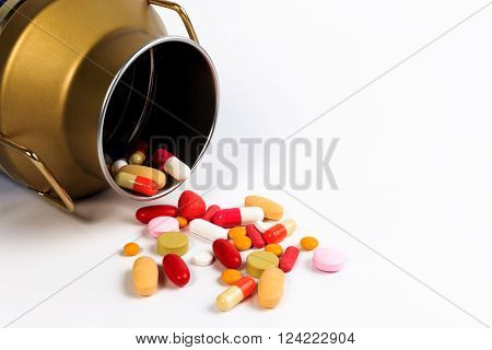Capsules And Pills In An Open Candy Bottle On The Table Isolated On White. Protect Against Diabetes.