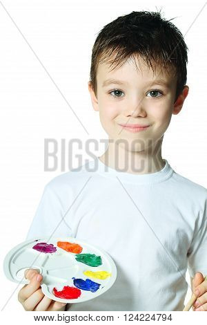 Young boy with paints on white background