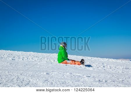 the guy in the snowy mountains with a snowboard