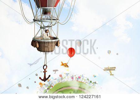 Elegant man traveling in aerostat