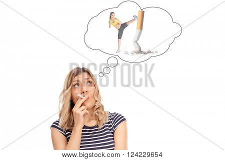 Young woman smoking a cigarette and thinking how to quit smoking isolated on white background