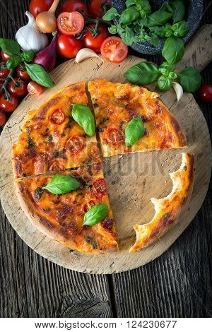 Homemade Pizza Margherita With Mozzarella, Basil And Tomatoes