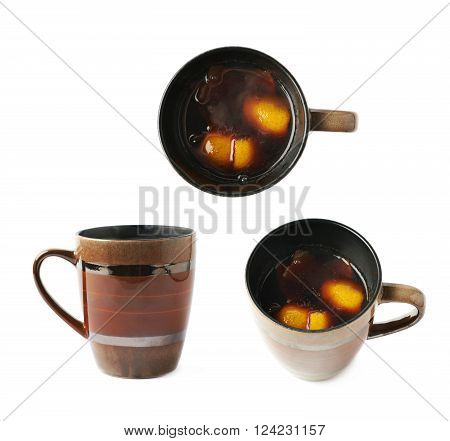 Mug filled with mulled wine and orange peels, composition isolated over the white background, set of three different foreshortenings