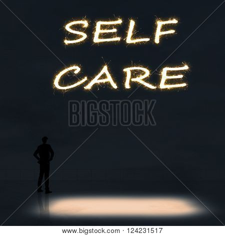 Concept of self care with a person stand in the outdoor and looking up the text over the sky in the night.
