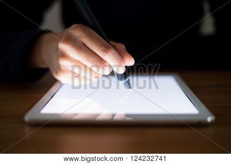 Woman using pen write on digital tablet pc