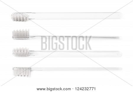 Brand new transparent plastic toothbrush with a white bristles isolated over the white background, set of four different foreshortenings