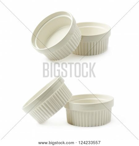 Two white porcelain souffle ramekin dishes, composition isolated over the white background, set of two different foreshortenings