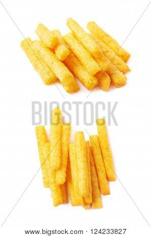 Pile of cheese puff stick corn snacks, composition isolated over the white background, set of two different foreshortenings