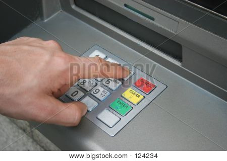 Hand Using ATM Keyboard