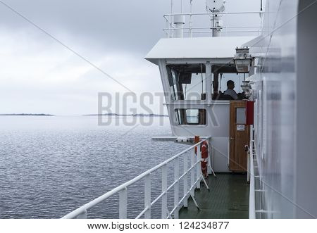BALTIC SEA, ALAND ON JUNE 27. View of the bridge on a ferry, ship in the archipelago on June 27, 2013 at The Baltic Sea, Aland. Unidentified person in the wheelhouse. Editorial use.