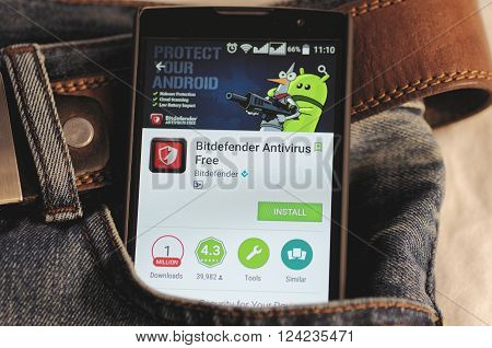 SARANSK, RUSSIA - April 3, 2016: Photo of Smartphone in a jeans pocket with Bitdefender Antivirus application in a Google Play Store on the screen.