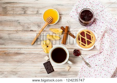 Mini Tart With Jam And A Cup Of Coffee