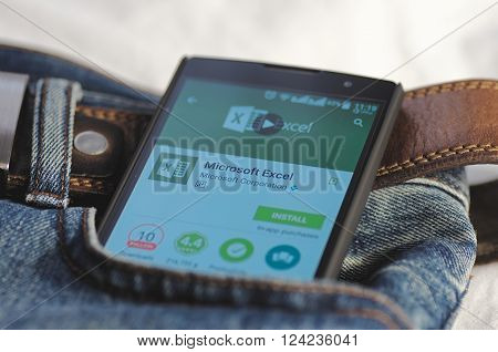 SARANSK, RUSSIA - April 3, 2016: Photo of Smartphone in a jeans pocket with Microsoft Excel application in a Google Play Store on the screen.