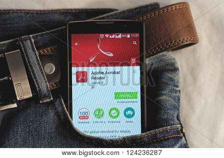 SARANSK, RUSSIA - April 3, 2016: Photo of Smartphone in a jeans pocket with Adobe Acrobat Reader application in a Google Play Store on the screen.