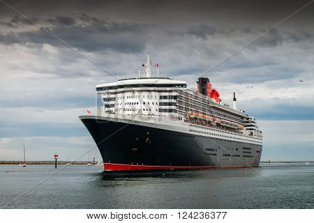 Adelaide Australia - March 10 2014: RMS Queen Mary 2 with people on board is leaving for cruise from Outer Harbour in Port Adelaide South Australia
