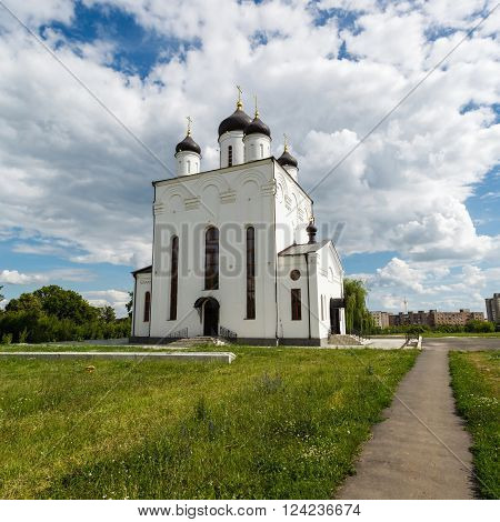 Russia. Holy Dormition Monastery. Orel, white church on background blue sky
