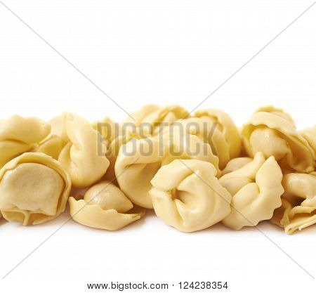 Line of stuffed ravioli dumplings isolated over the white background, close-up fragment crop as a copyspace backdrop composition