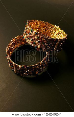 Bangle. Colorful traditional jewelry from India and Pakistan on black background