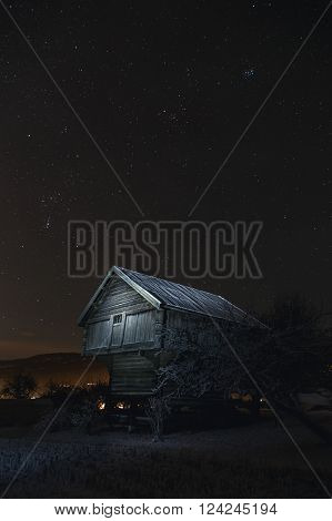 Granary (old storehouse) in the cold night of winter
