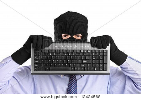A Hacker With Robbery Mask Holding A Keyboard