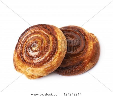 Two cinnamon roll pastry buns, composition isolated over the white background