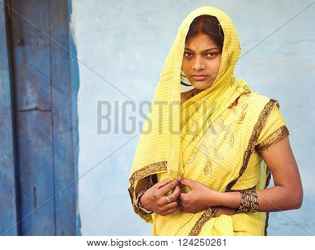 Jodhpur, India - February 11, 2013: Unidentified Indian woman wearing traditional sari dress in Jodhpur, Rajasthan, India.