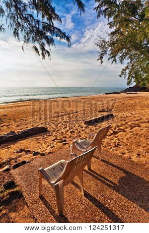 chairs on a tropical beach with sunset views. Fish-eye lense view