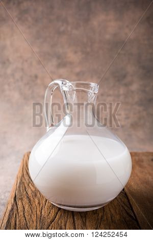 Fresh rice milk in glass pitcher. Helthy, lactose intolerance, diet and vegan concept.