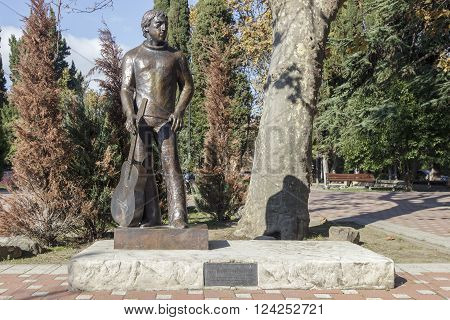 SOCHI, RUSSIA - November 06, 2016: The guitarist Vysotsky holds a guitar - a monument near the Amusement park and Arts Square. Sochi, Russia