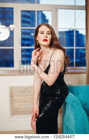 Woman In Luxury Black Dress With Slit