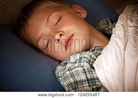 Male Child Sleeping In Bed