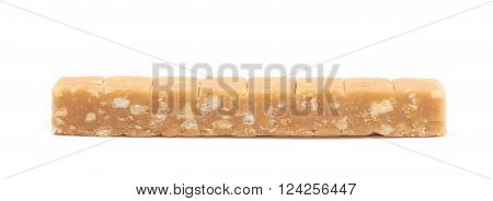 Toffee candy with nuts isolated over the white background