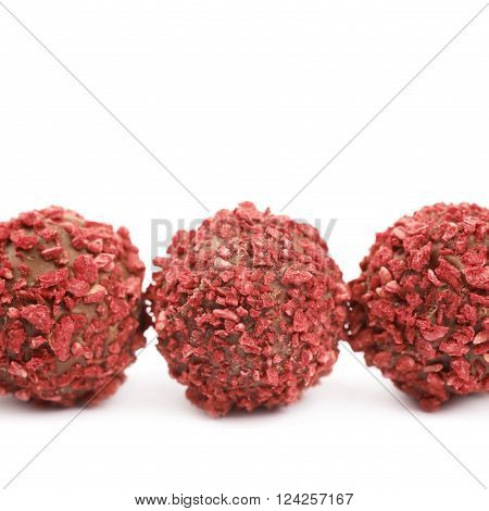 Line of handmade red candy balls, composition isolated over the white background, close-up crop fragment