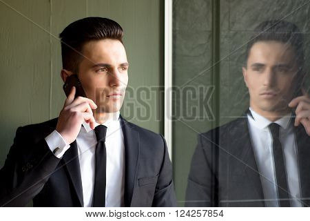 Man Talks On Mobile Phone