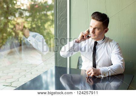Man Talks On Phone